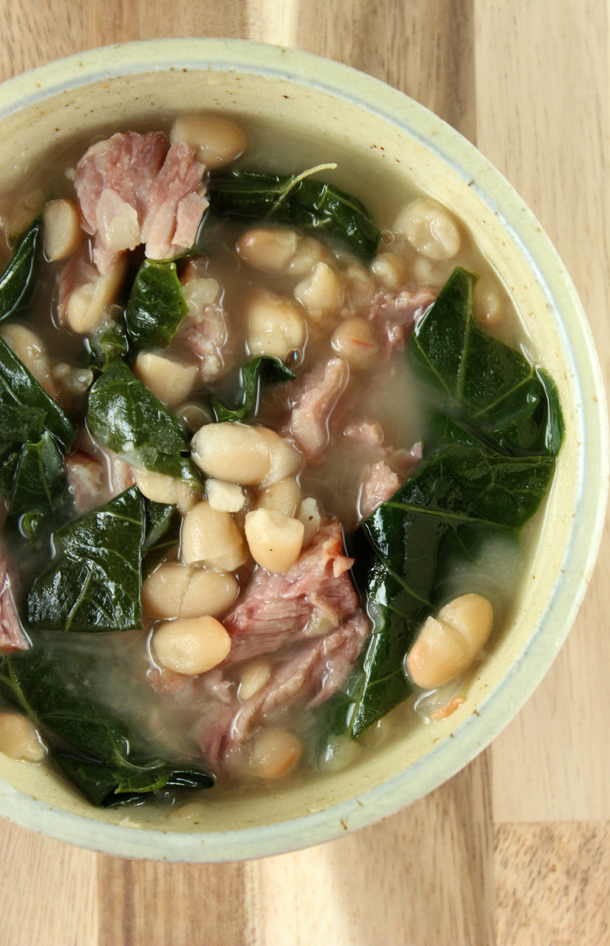 Slow cooked ham and beans with collared greens.