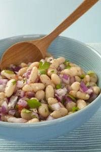Italian cannelini bean salad of beans in lemon vinaigrette with red onion, rosemary, parsley and garlic.