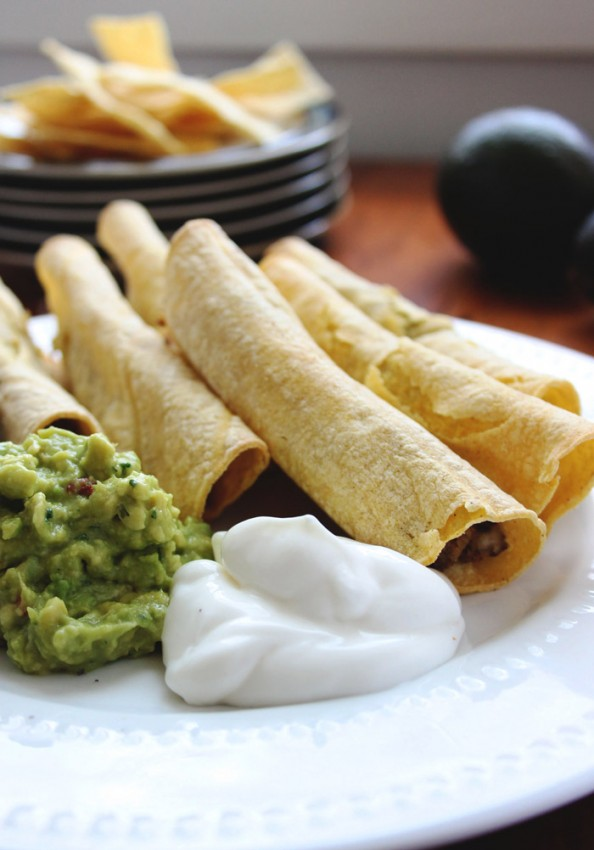 Low fat baked taquitos with Randall's Black Beans.