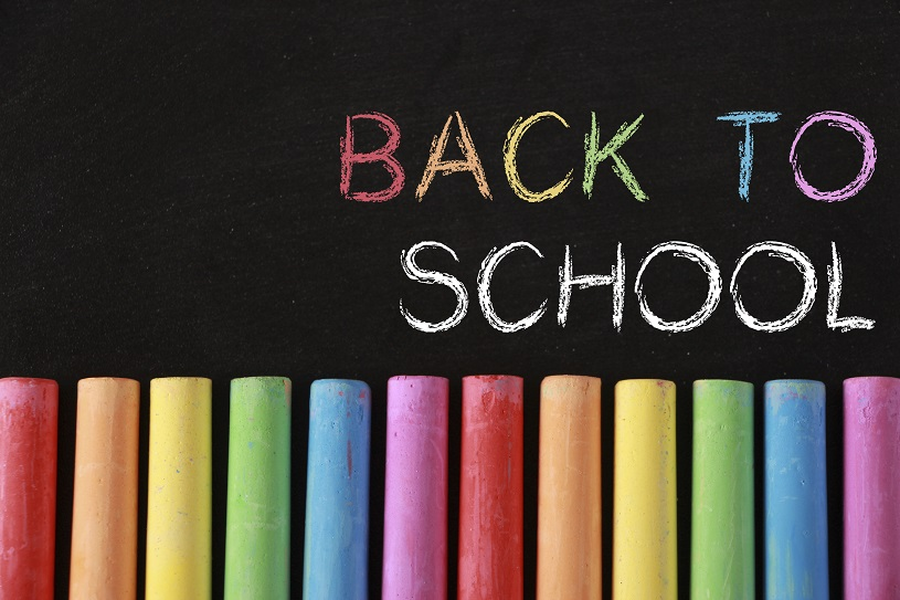 Back to school concept with colorful chalk and blackboard background.