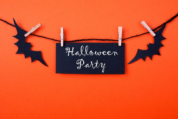 Black Label with the Words Halloween Party on Orange Background
