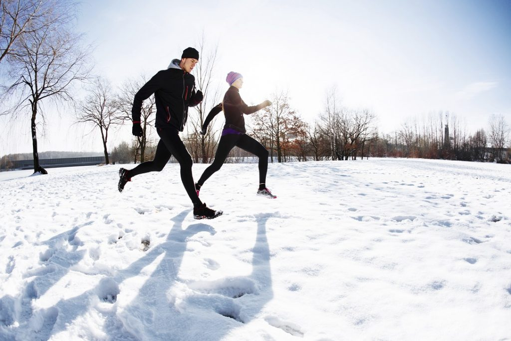 Couple running on snow