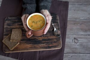 woman holding fall bean soup