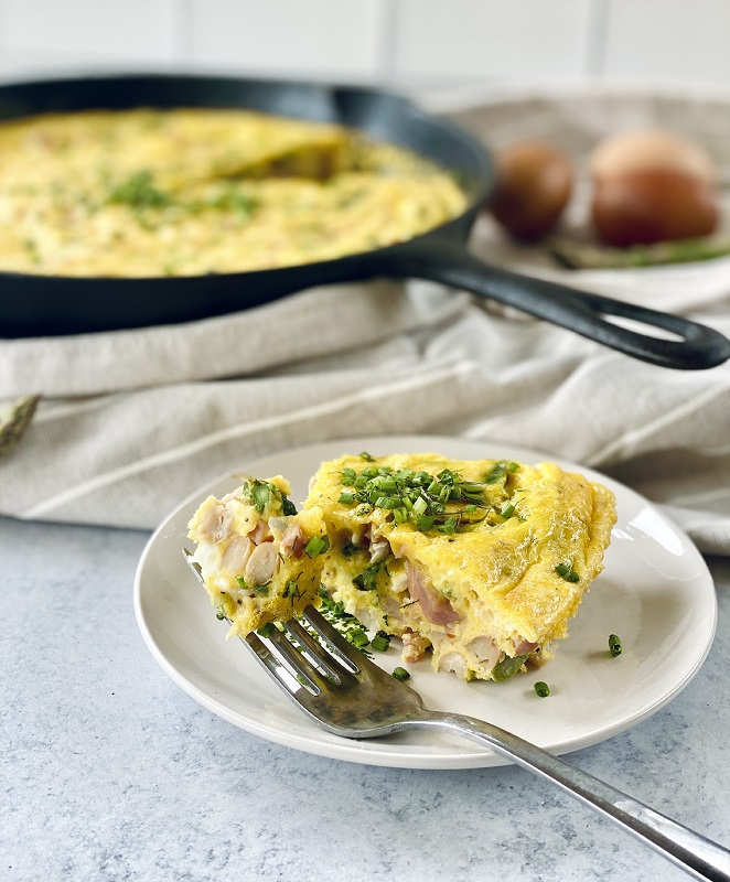 spring frittata made with white beans and leftover ham