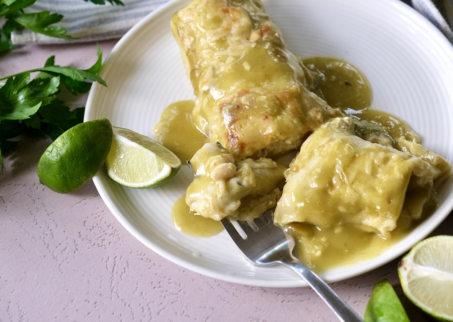 these great northern bean and chicken enchiladas are a simple, delicious, and inexpensive weeknight meal.